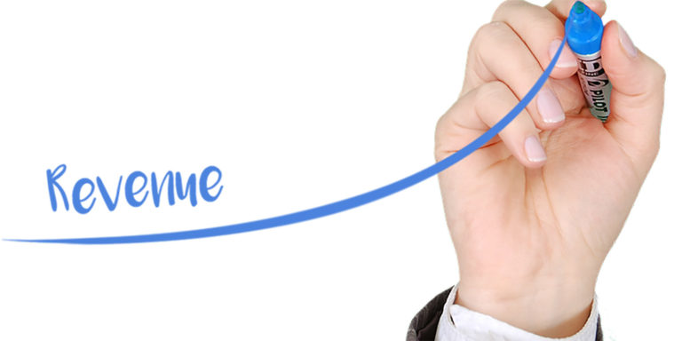 Person writing the word revenue with blue marker to show increased sales