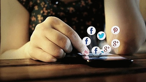 Woman thumbing through social platform notifications from Facebook, Twitter, and Google Plus