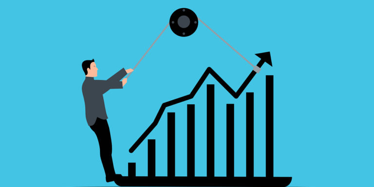 Man-in-suit-leveraging-pulley-on-bar-chart-to-move-arrows-upward