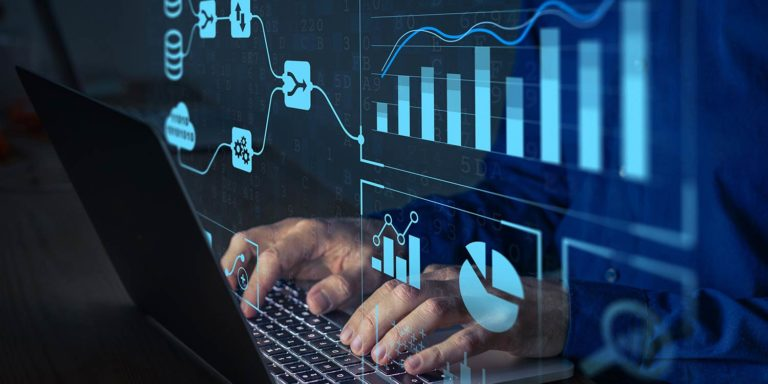 Man sitting at keyboard with numerous graphs and charts floating around him.