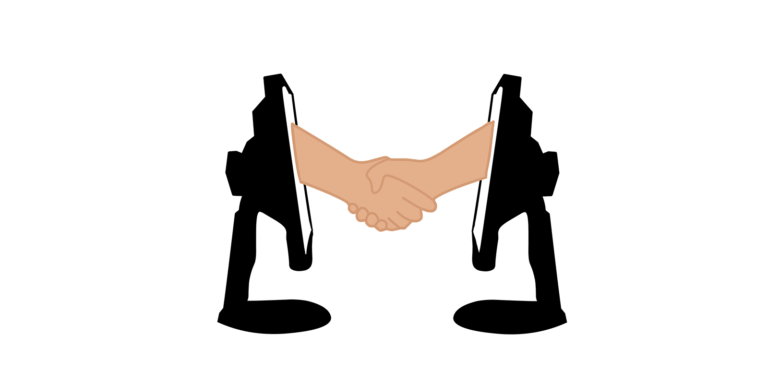 Two arms coming out of two computers shaking hands.